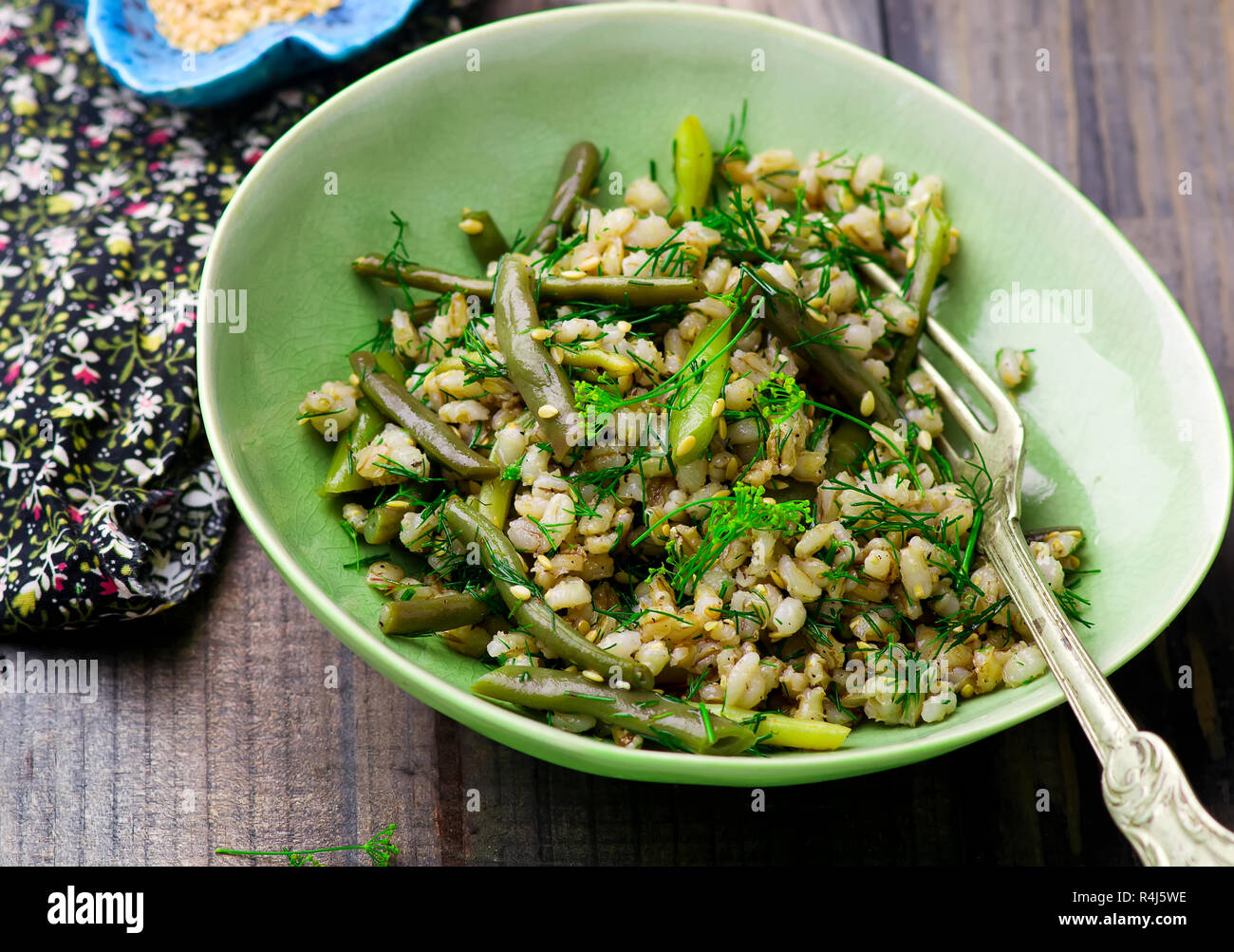 Salad from green beans and barley groat . style rustic. selective focus - Stock Image