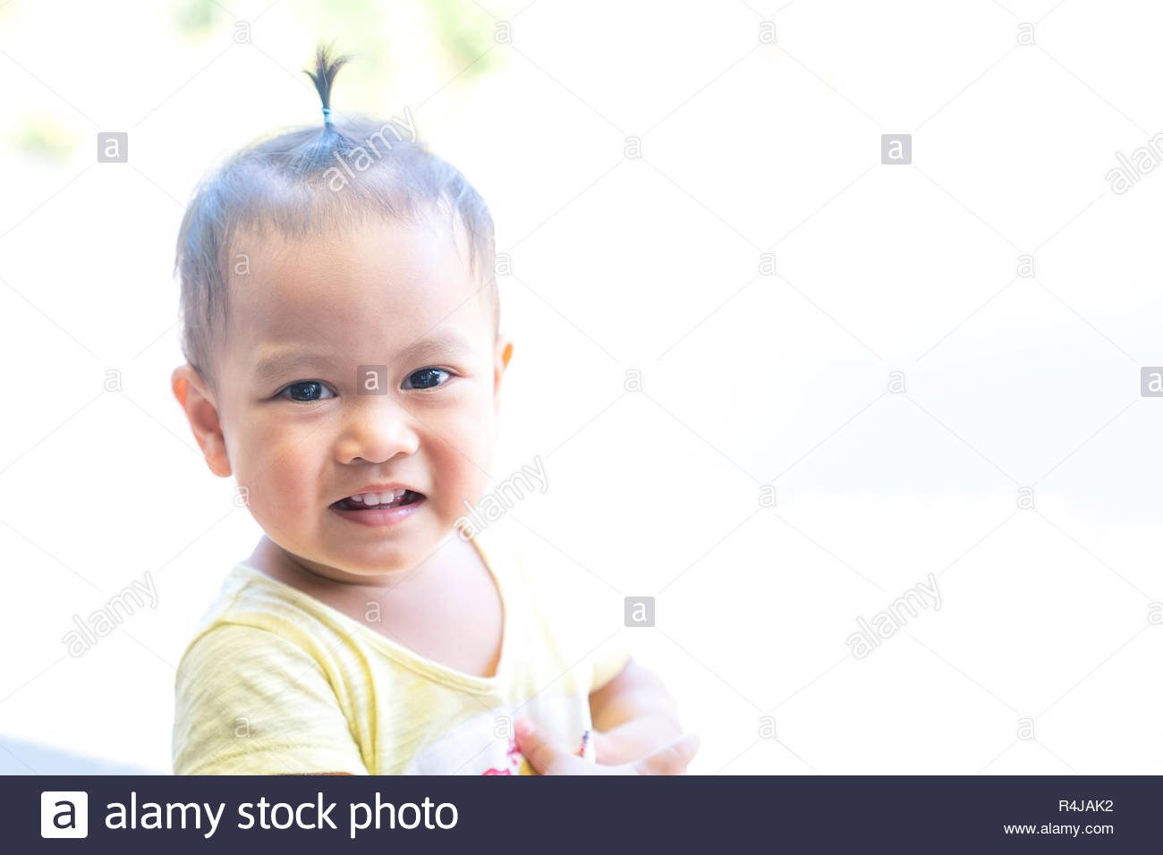 Asia baby smile and first milk tooth Stock Photo