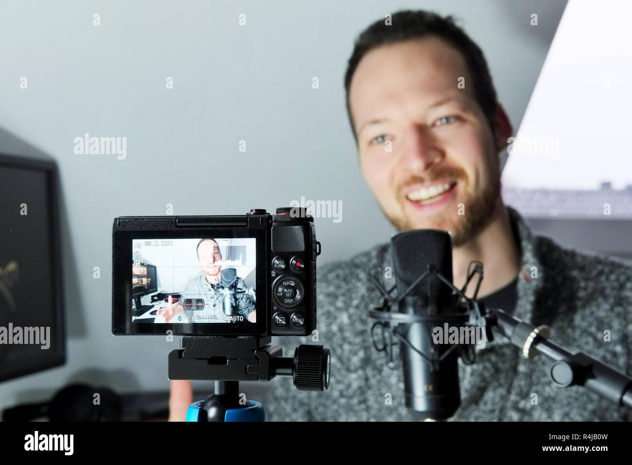Camera display showing young male filming himself podcast content creator Stock Photo
