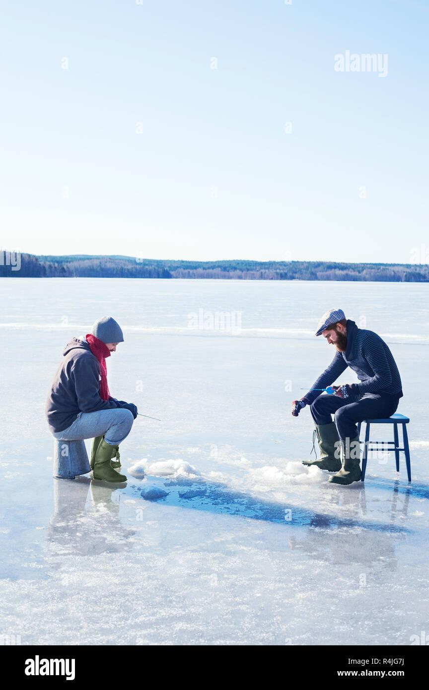 Fishing on a frozen lake in Dalarna, Sweden - Stock Image