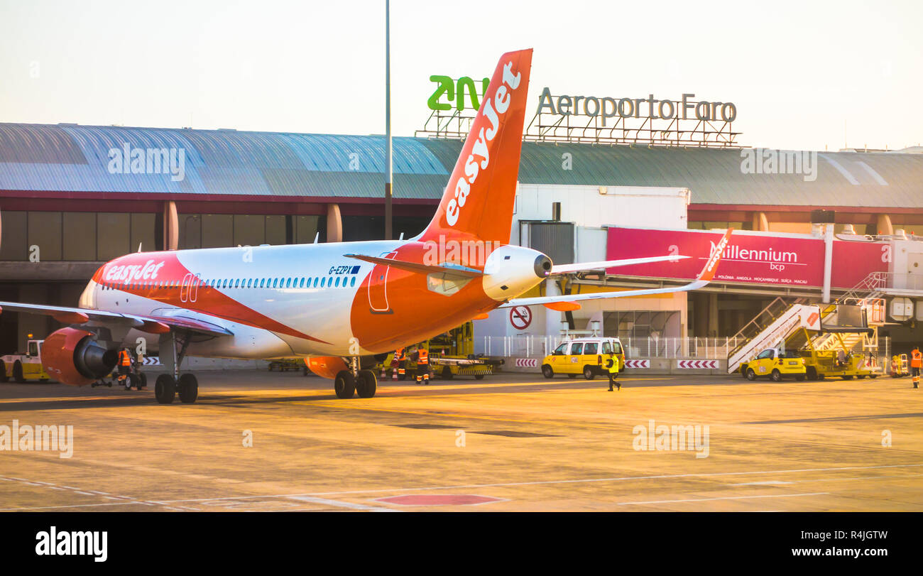 aircraft of easy jet fleet at faro airport - Stock Image