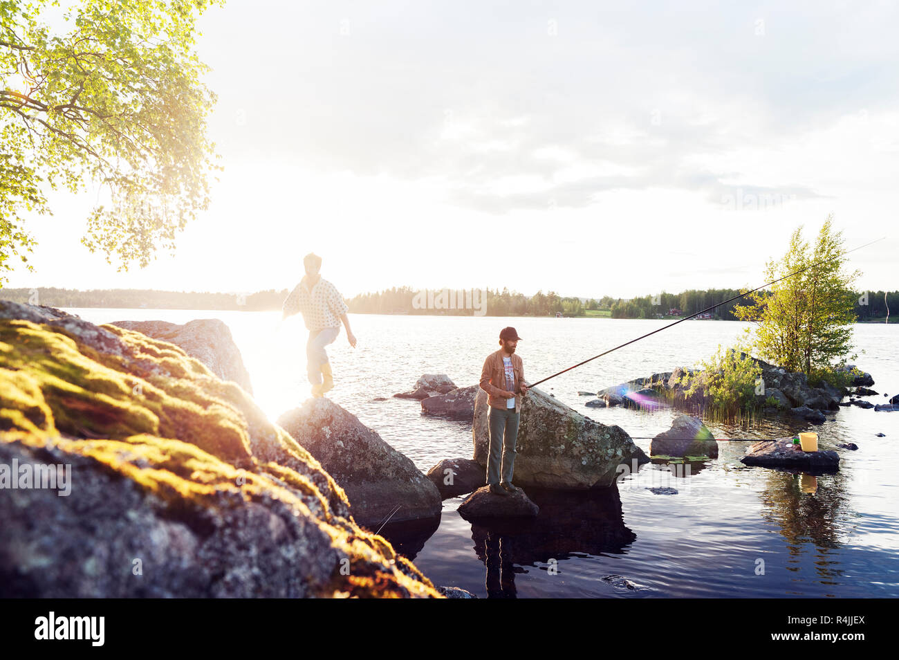 Friends fishing on a lake in Dalarna, Sweden - Stock Image