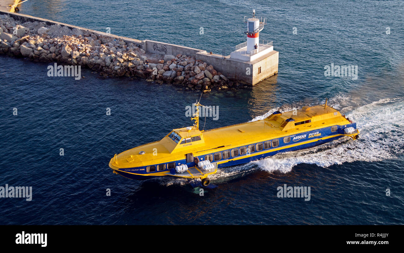 Aegean Flying Dolphins fast passenger ferry Flying Dolphin Athina passing port entrance in Piraeus Athens Greece Europe - Stock Image