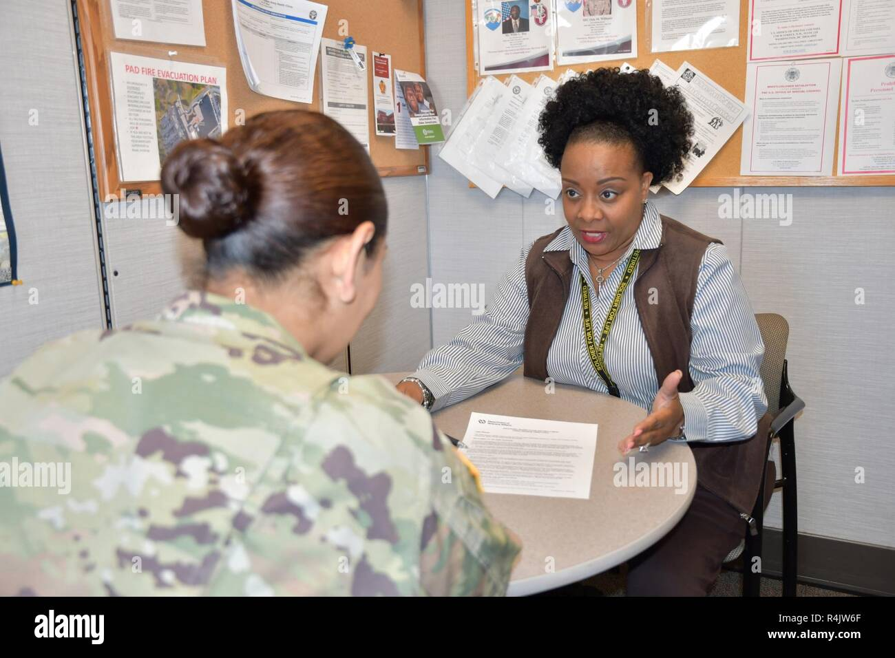 Vivian Harper-Hampton, the Vocational Rehabilitation counselor at Kenner Army Health Clinic, answers a Soldier's question about a service-connected disability during an office visit Oct 29, 2018 ( - Stock Image