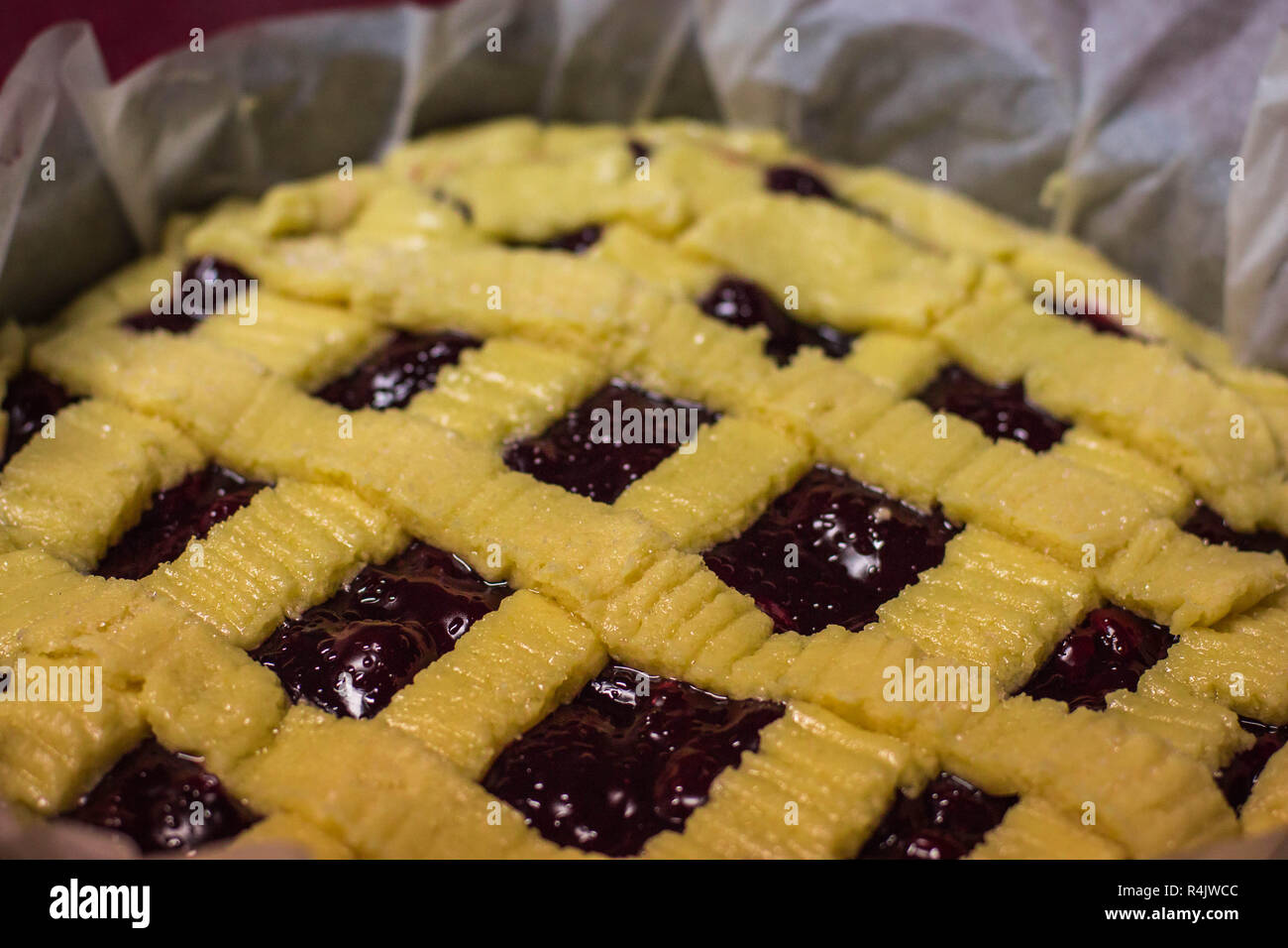 Unbaked homemade american pie with cherry - Stock Image