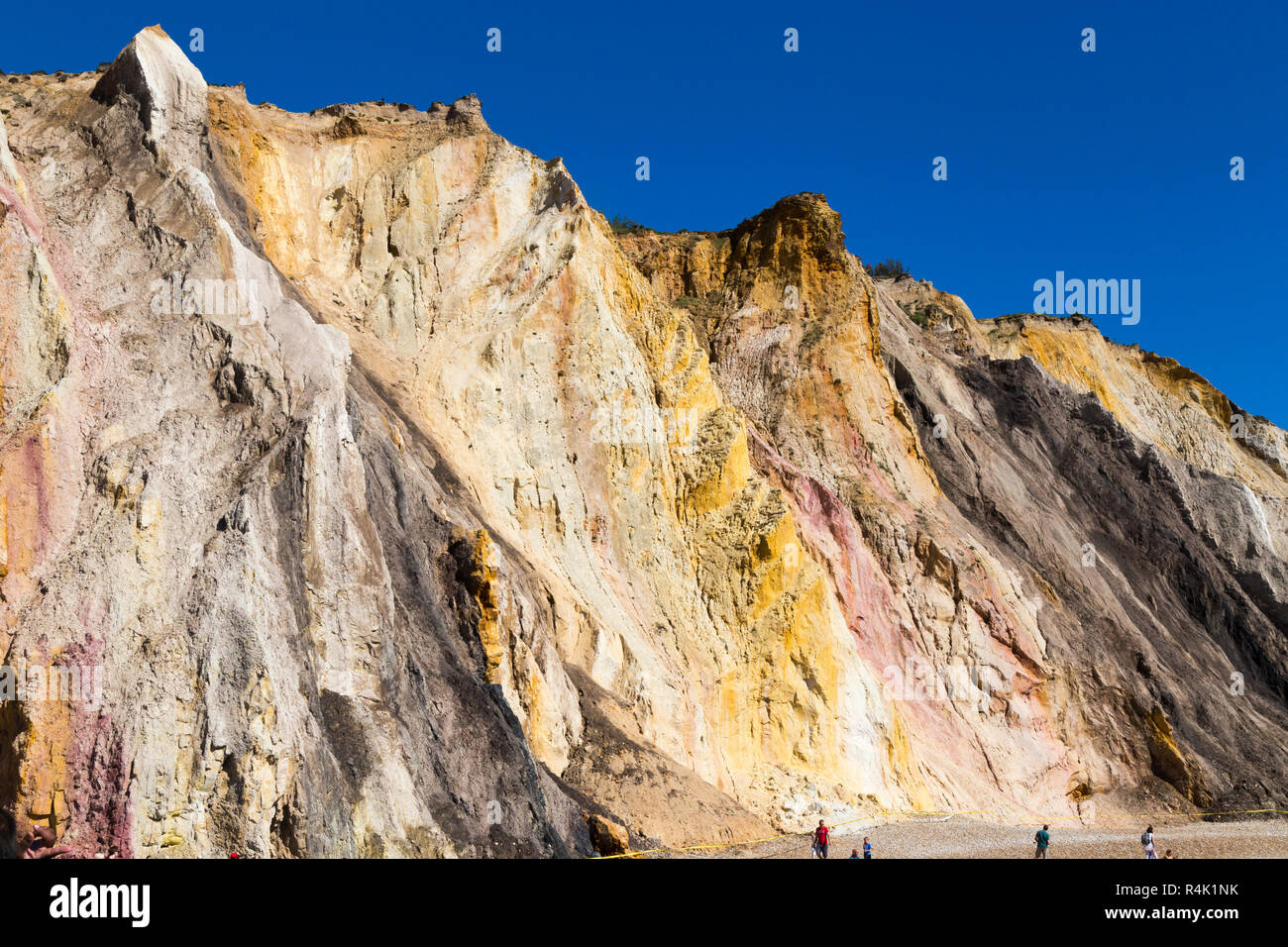 Famous multi coloured layered sands of the sandy cliffs of Alum Bay Cliffs. The different colours of sand can be clearly seen. The Needles. Isle of Wight. UK (98) - Stock Image