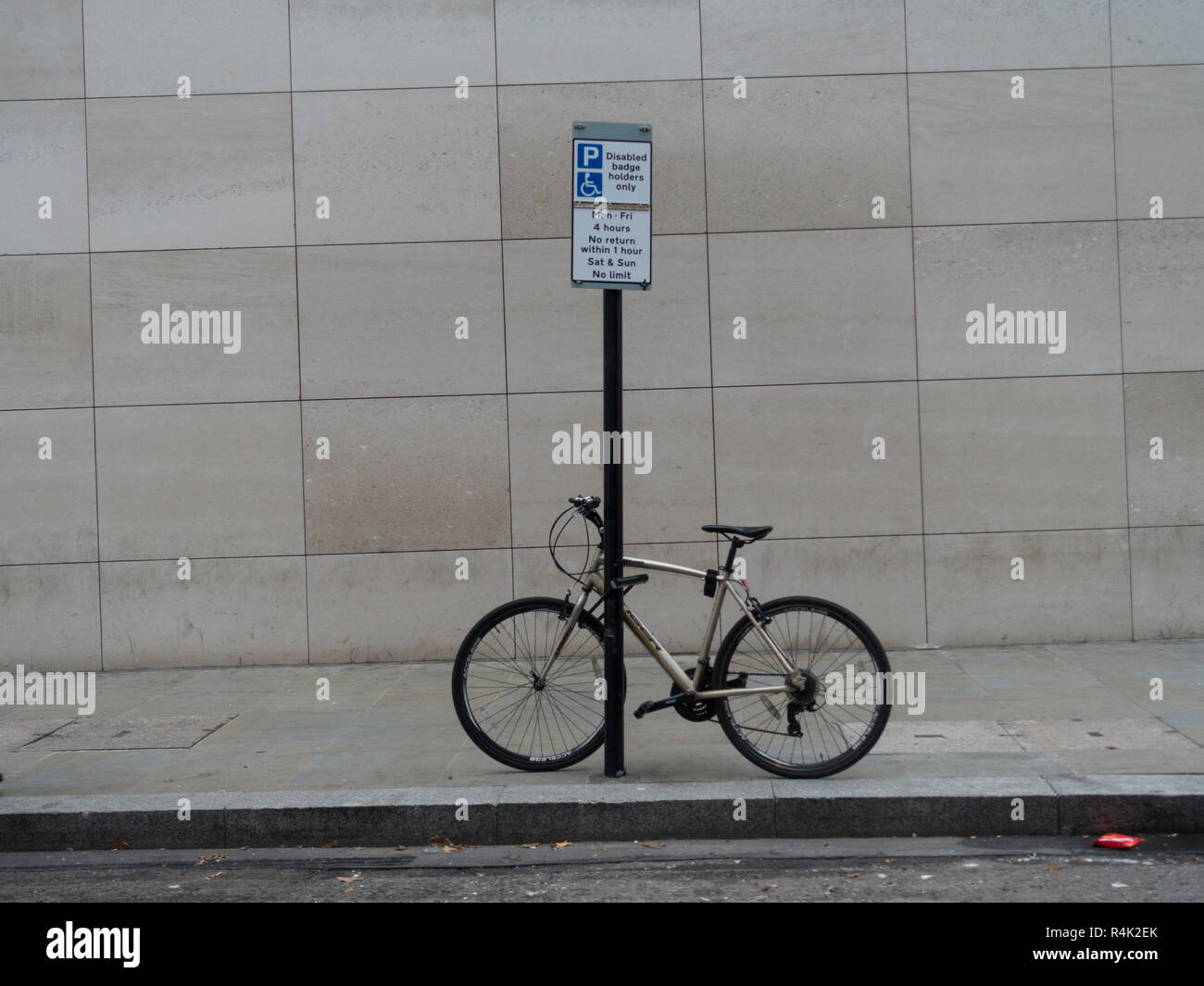 A bicycle chained to a post Stock Photo