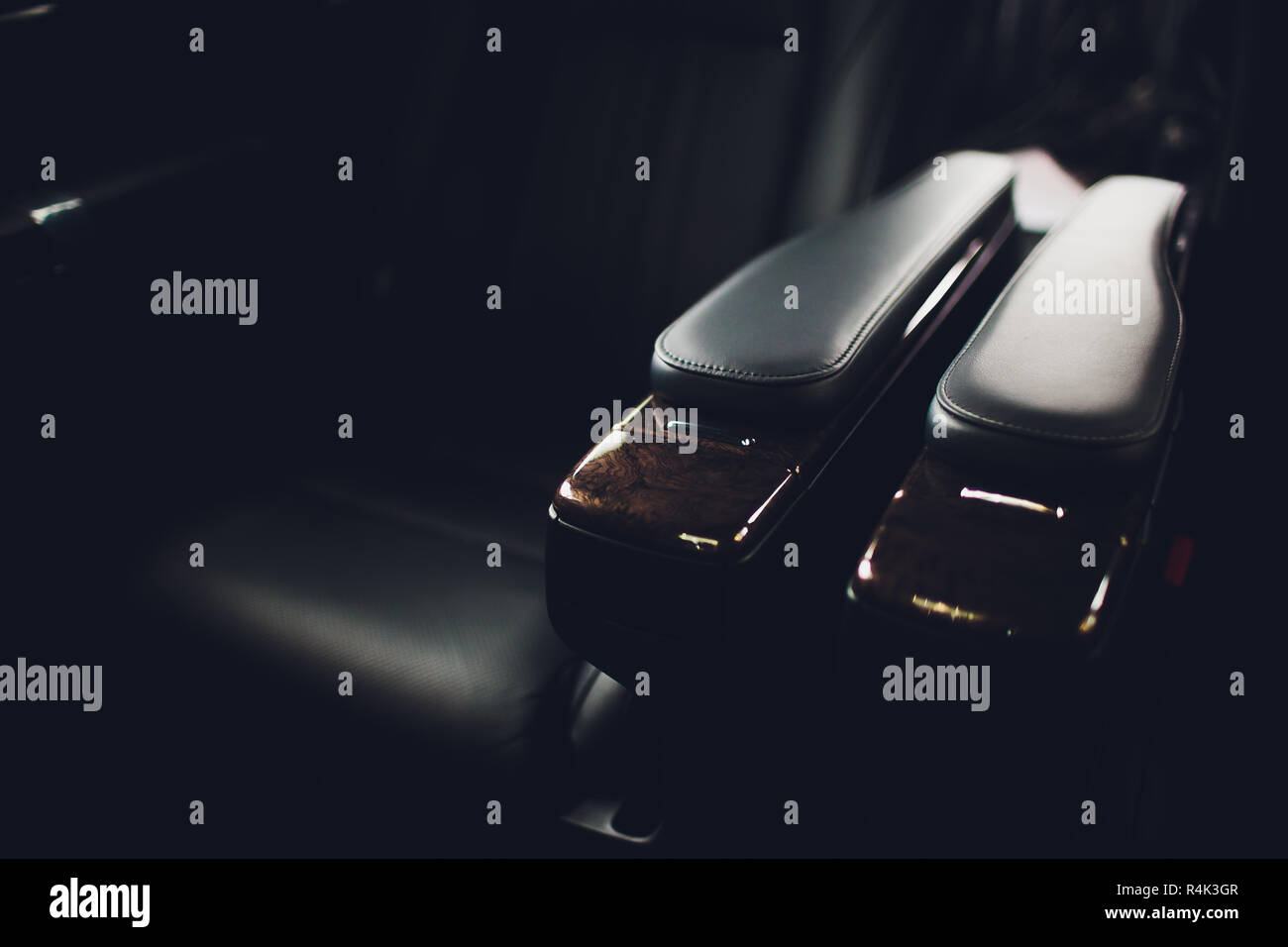 Luxury car inside. Interior of prestige modern car. Comfortable leather seats. Black perforated leather cockpit with isolated black background. Stock Photo