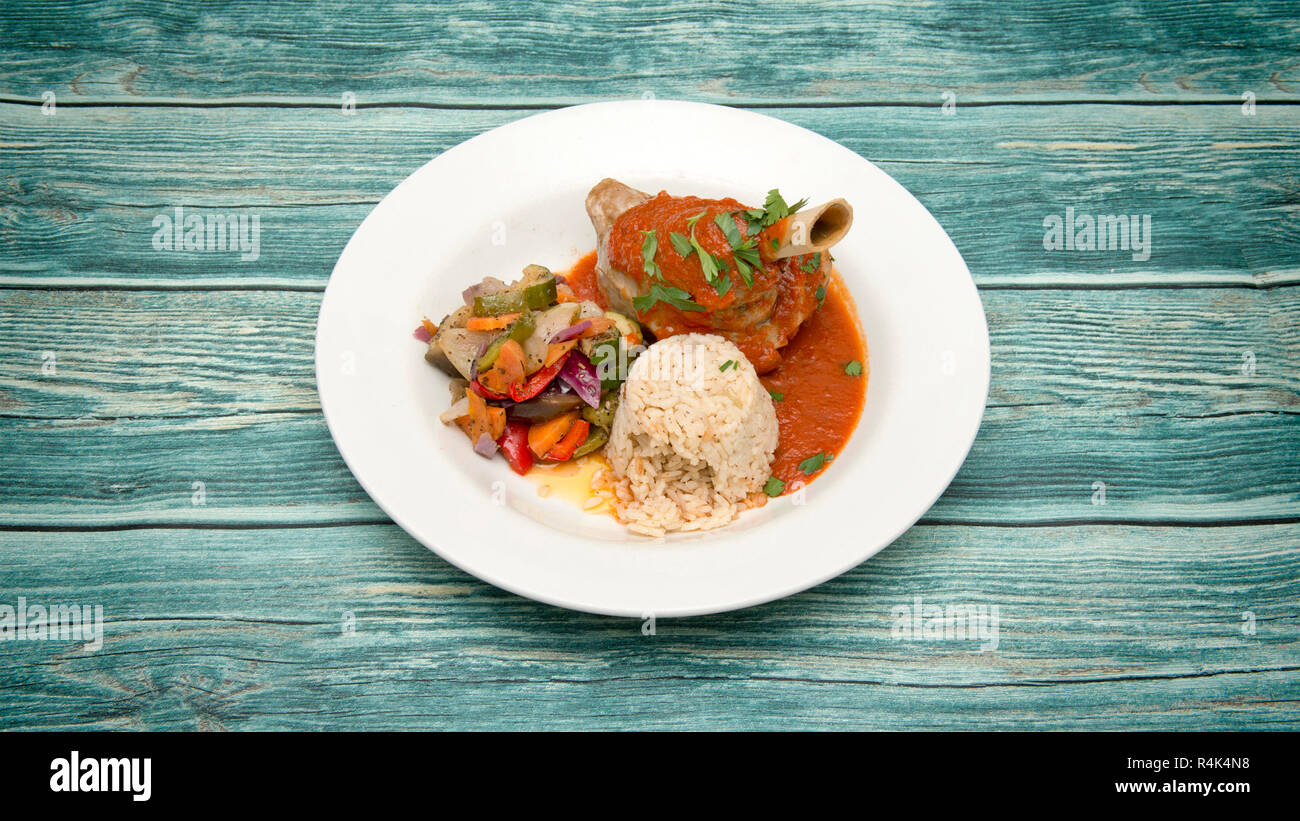 A selection of Mediterranean foods, lamb shank kleftico - Stock Image