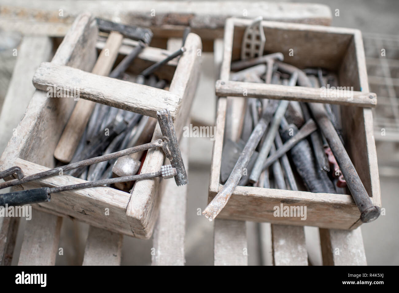 Sculptor's working tools in the wooden boxes - Stock Image