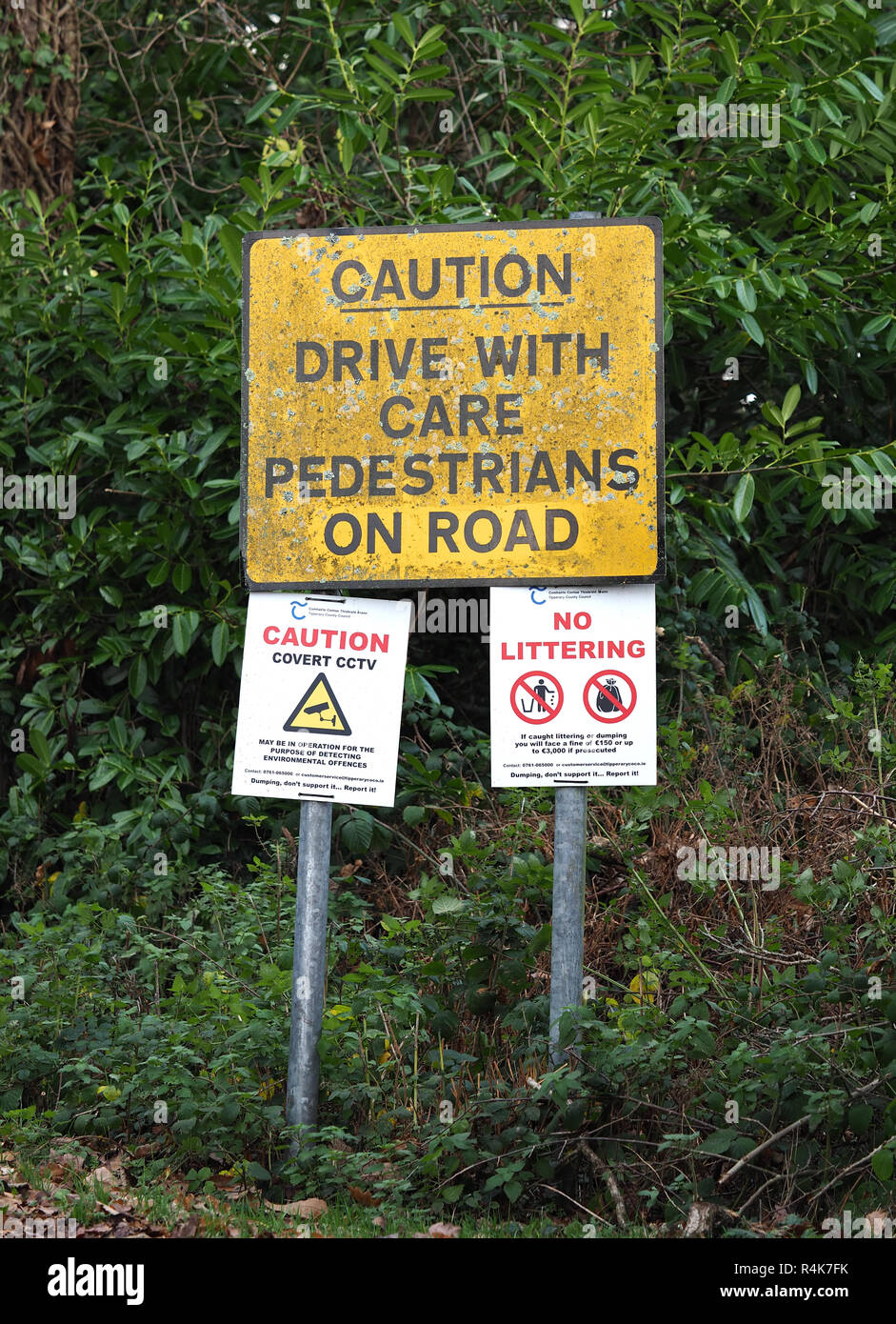 Roadsign advising drivers to drive with care. Tipperary, Ireland - Stock Image