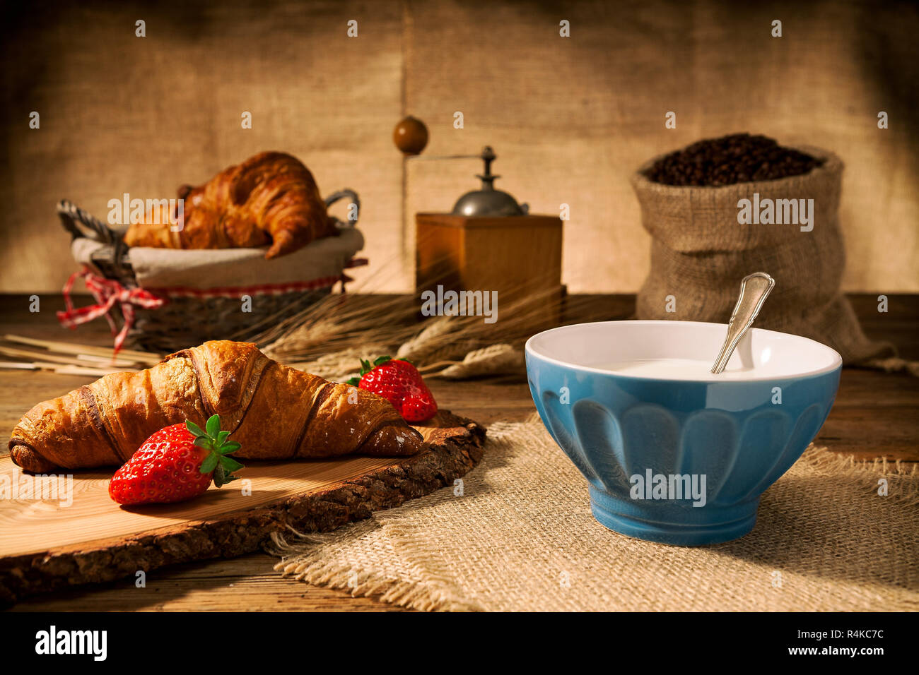 Continental breakfast with croissant and milk - Stock Image