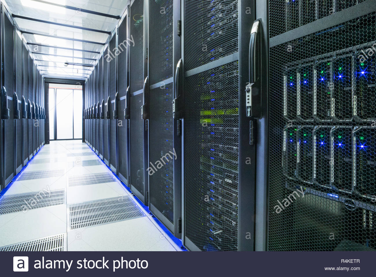 Mainframe computers in centre of data center server farm. - Stock Image