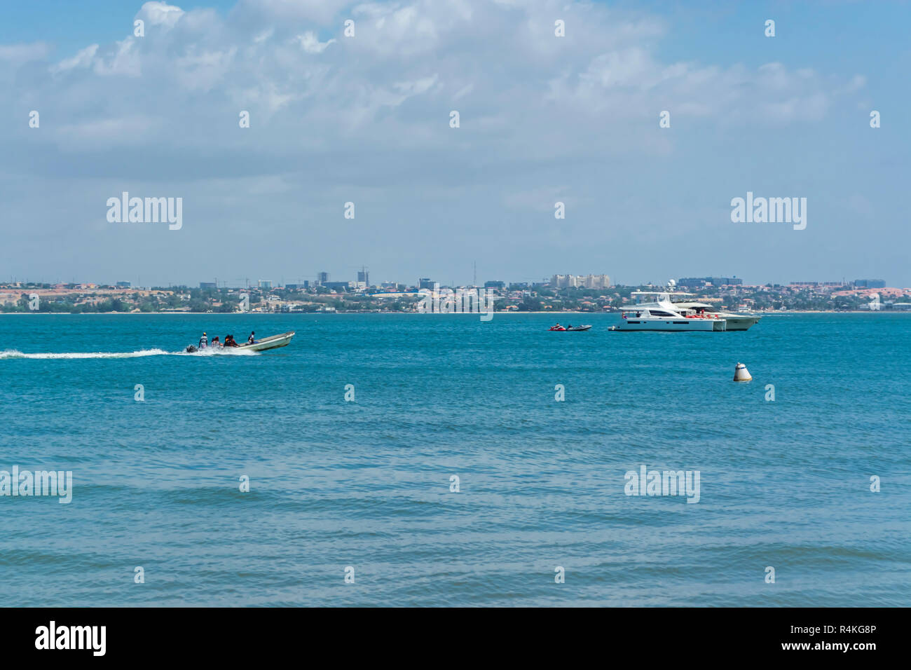 View at the beach and boats on water, on the Mussulo Island, Luanda, Angola - Stock Image