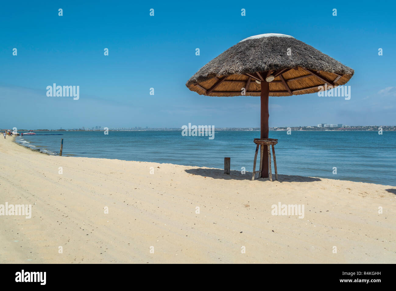 Straw parasol on tropical and paradisiac beach, in Angola - Stock Image