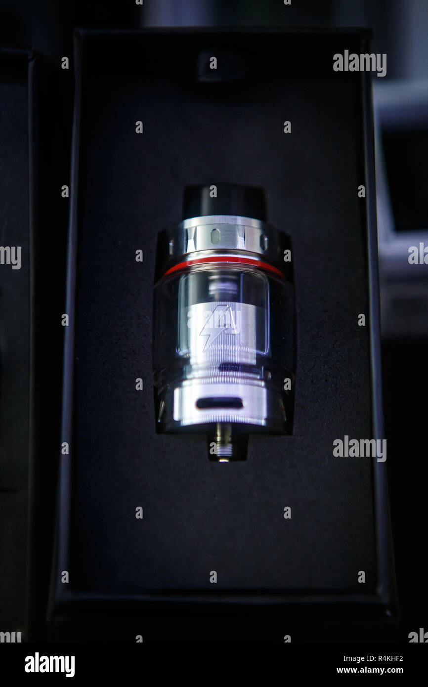 KIEV,UKRAINE-28 OCTOBER,2018: Buy modern vaping device and dripper head for smoking ejuice liquid. New vape drip head for box mod gadget in store - Stock Image