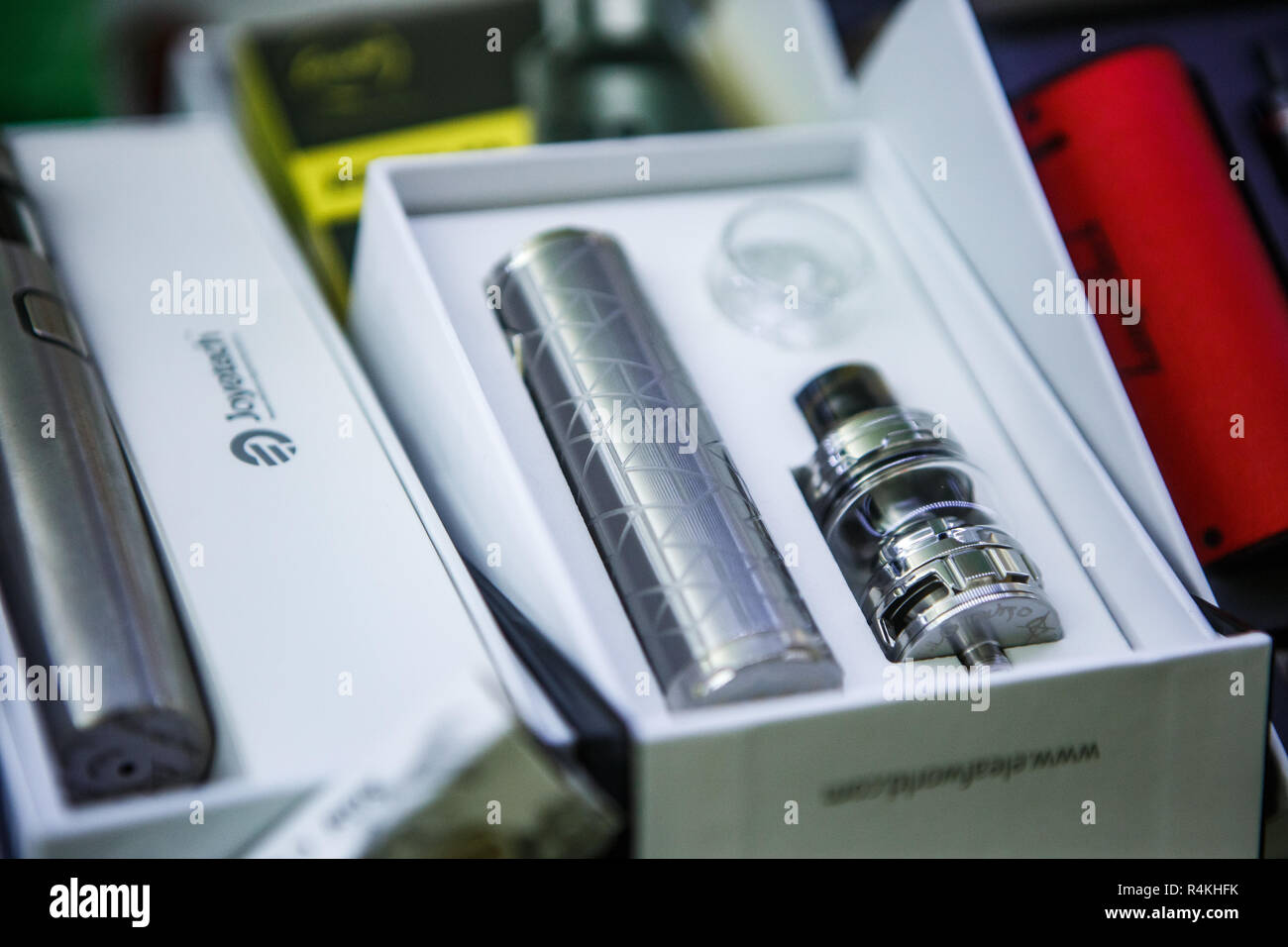 KIEV,UKRAINE-28 OCTOBER,2018: New vaping device and dripper head with titanium wire for smokine e-liquid. Buy new vaper gagdet in store - Stock Image