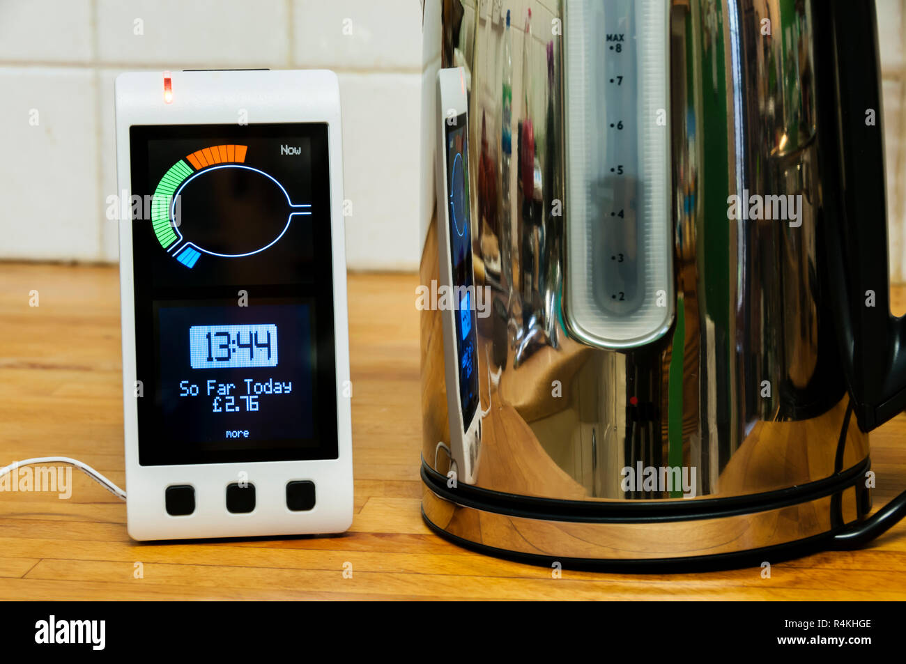 A Geo Smart Meter provided by EDF Energy in a domestic kitchen.  Shows cost of energy consumed during day. - Stock Image