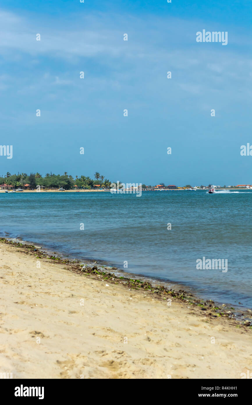 View at the beach and jet boat with people on water, on the Mussulo Island, Luanda, Angola - Stock Image