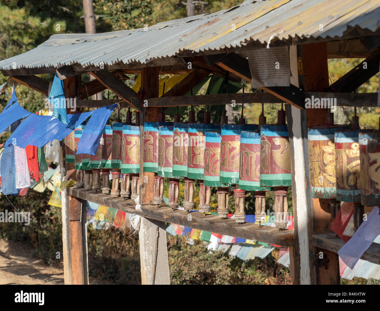 Prayer Wheels on the path to Taktsang Monastery, Bhutan - Stock Image