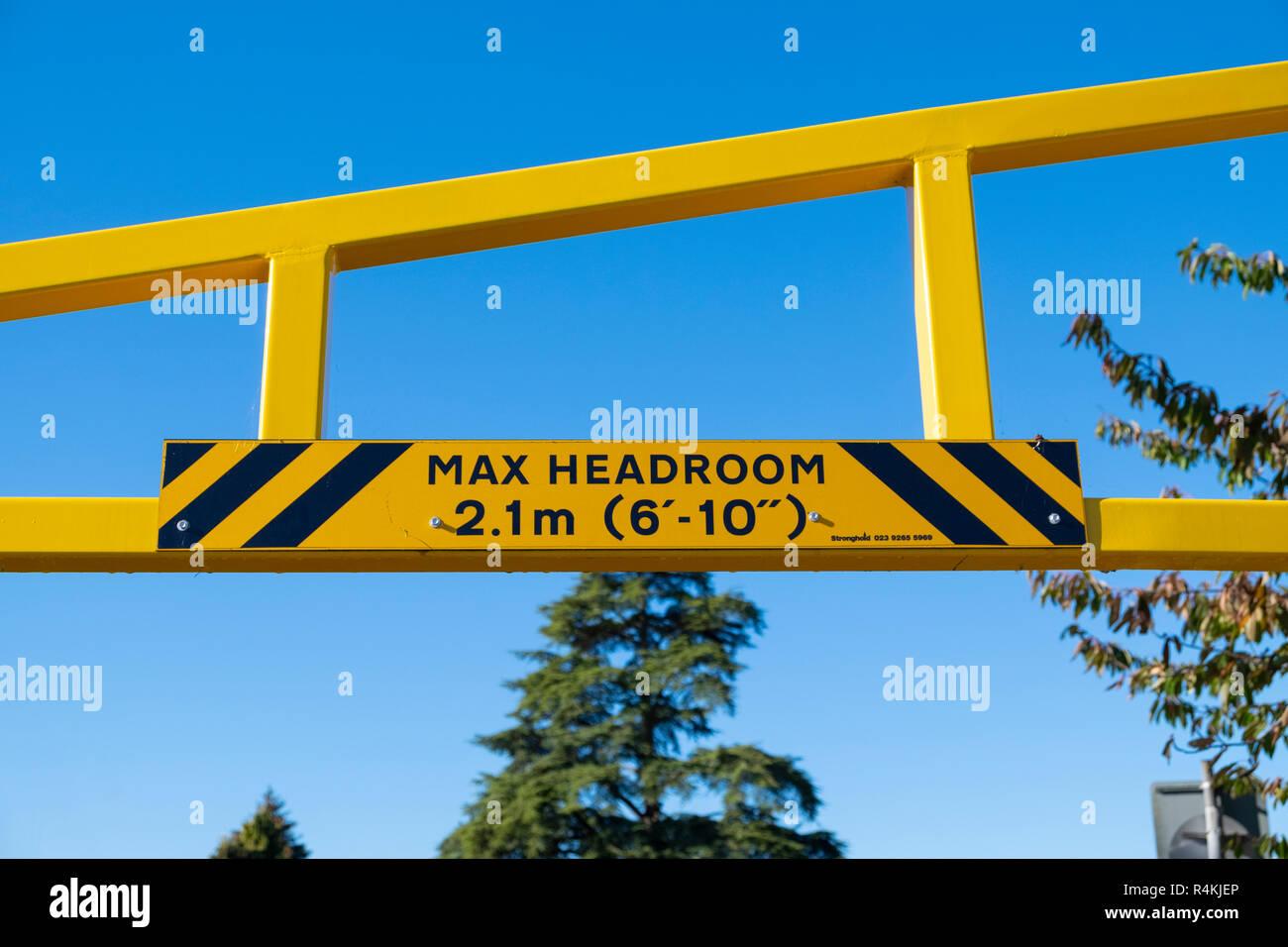 Maximum headroom sign in a car park - Stock Image