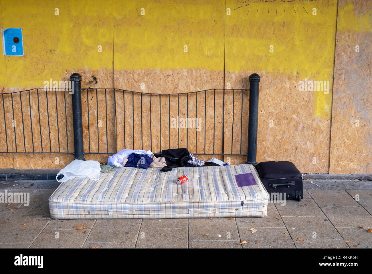 Homeless person's mattress, clothes and case - Stock Image