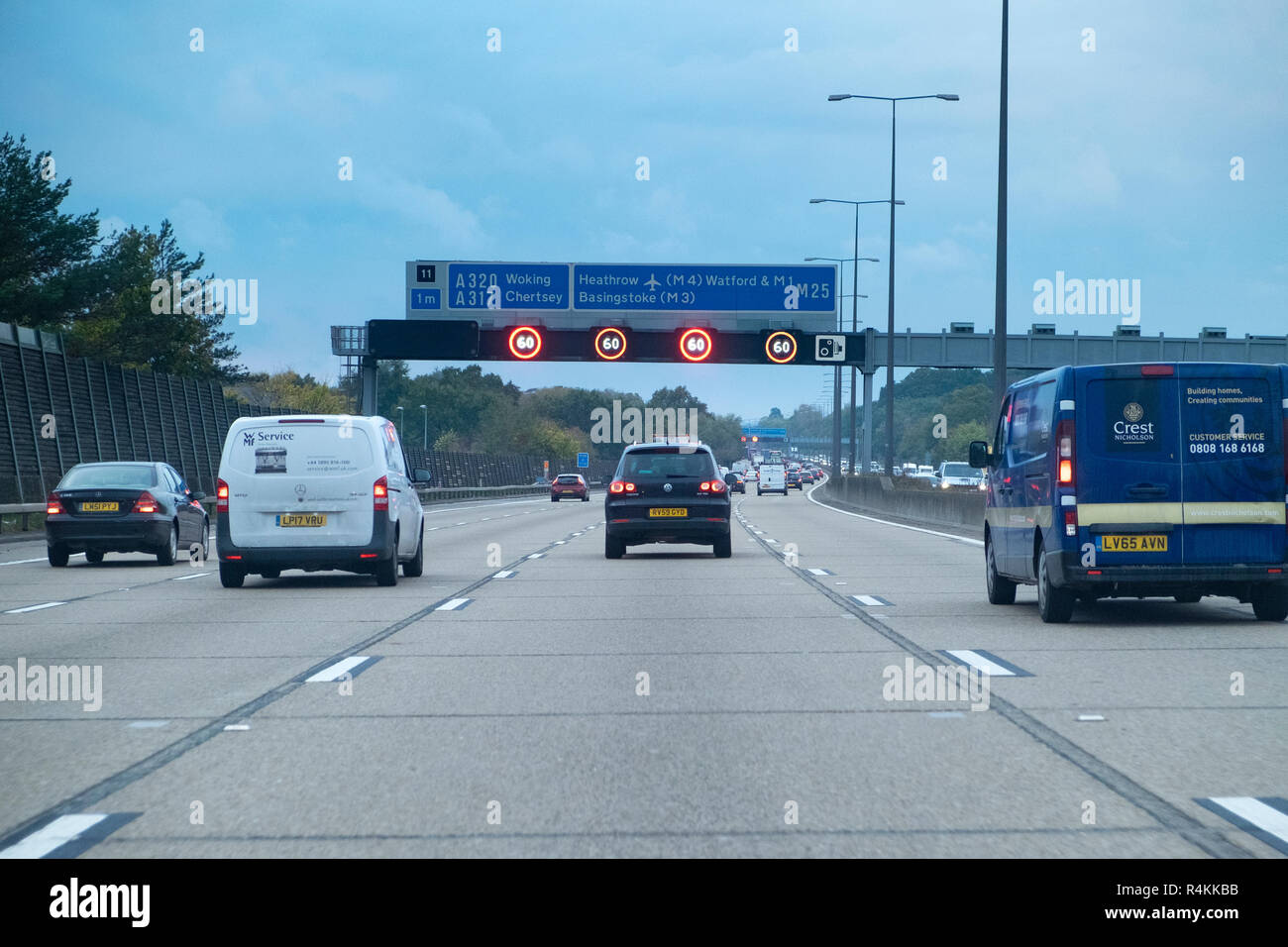 M25 motorway with 60mph speed limit signs illuminated - Stock Image