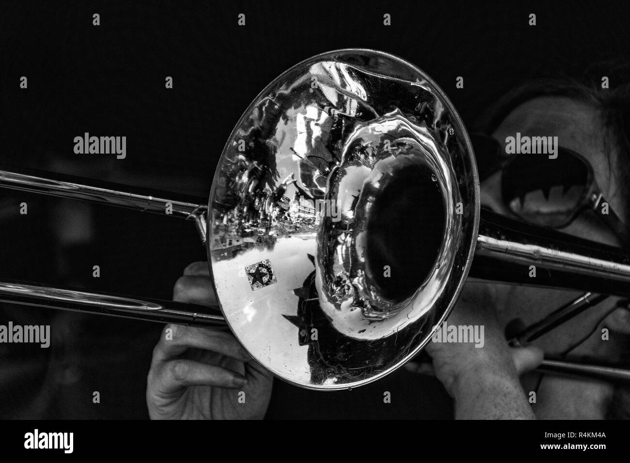 Brass Disciple: Black and White Processed, Close-Up Detail of a Trombone with player. - Stock Image