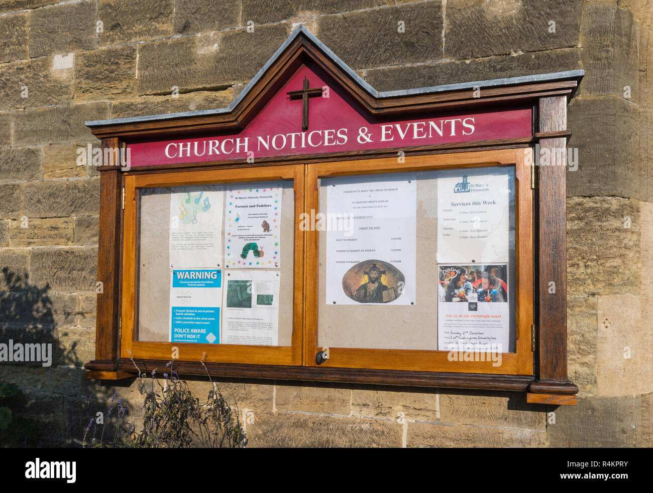 Church notice and events noticeboard at a church in England, UK. - Stock Image