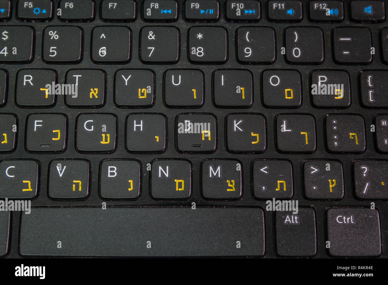 Keyboard with letters in Hebrew and English - Laptop keyboard - Top View - Close up - Stock Image