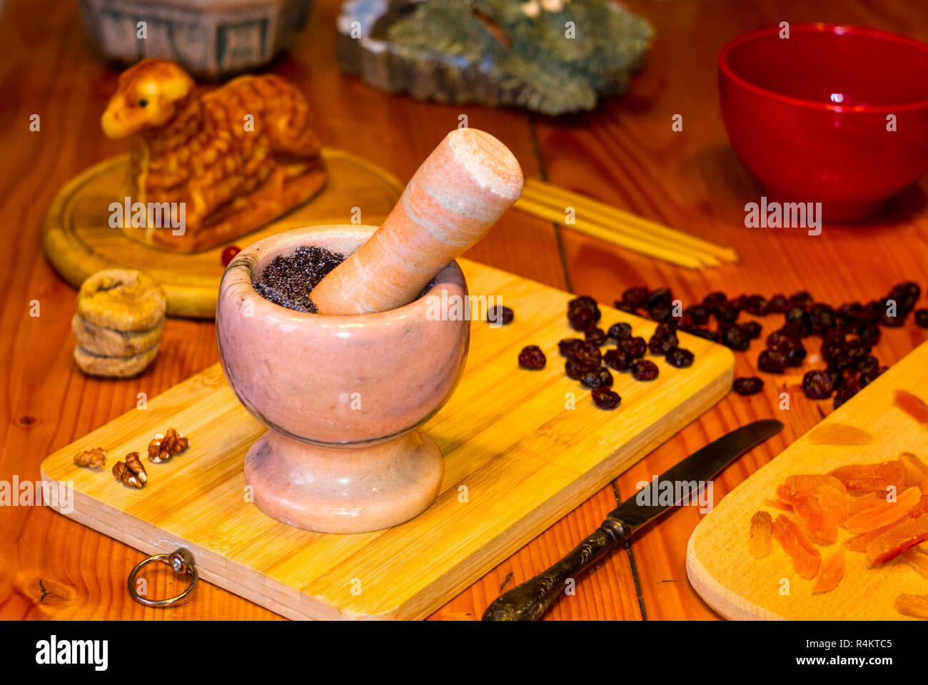 preparation of treats for traditional Orthodox Christmas - handmade baked cookies in the form of lambkin, dried fruits, cranberries, honey, nuts, rice - Stock Image