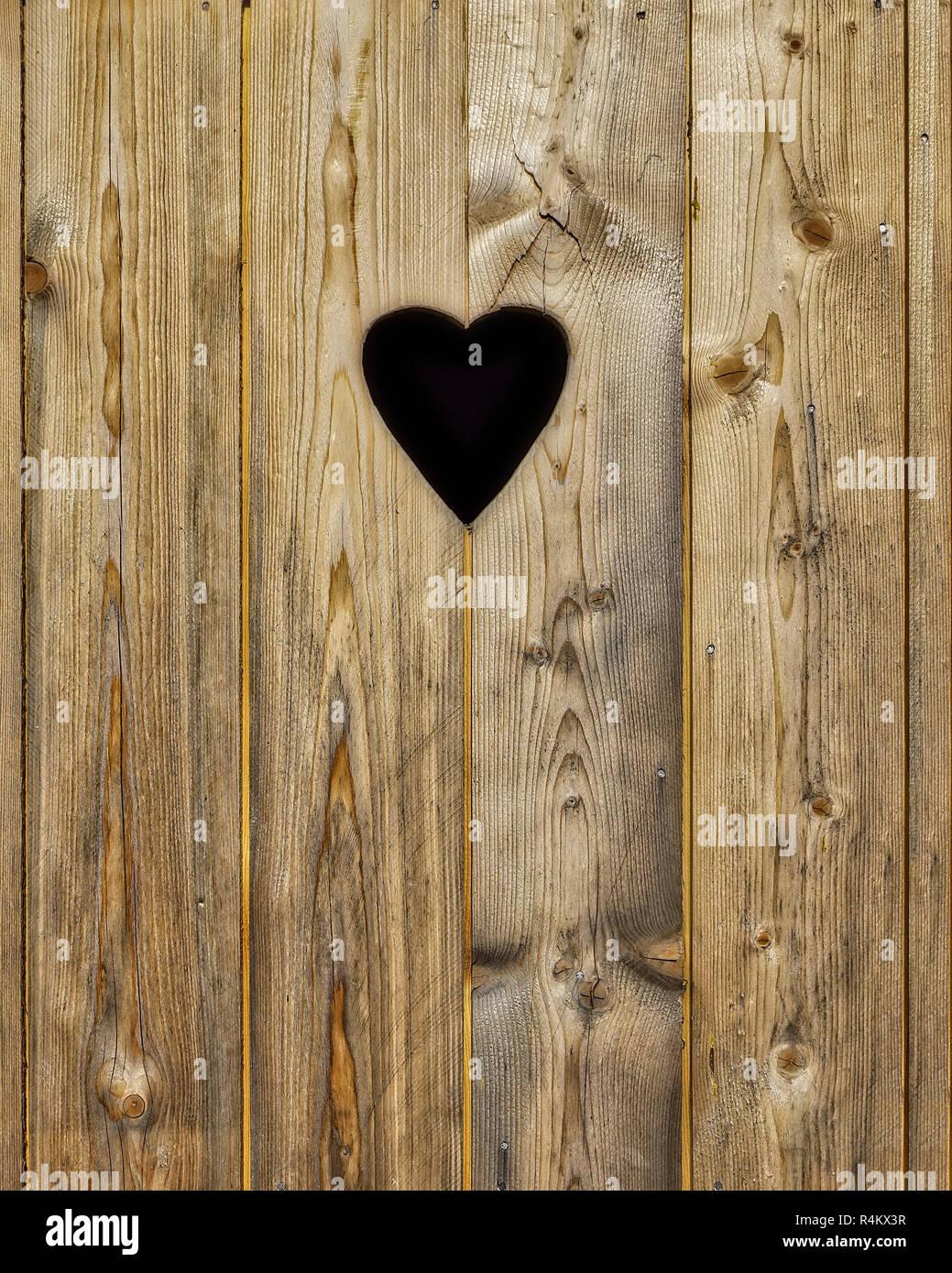 DE - BAVARIA: Detail of traditional outdoor toilet door - Stock Image