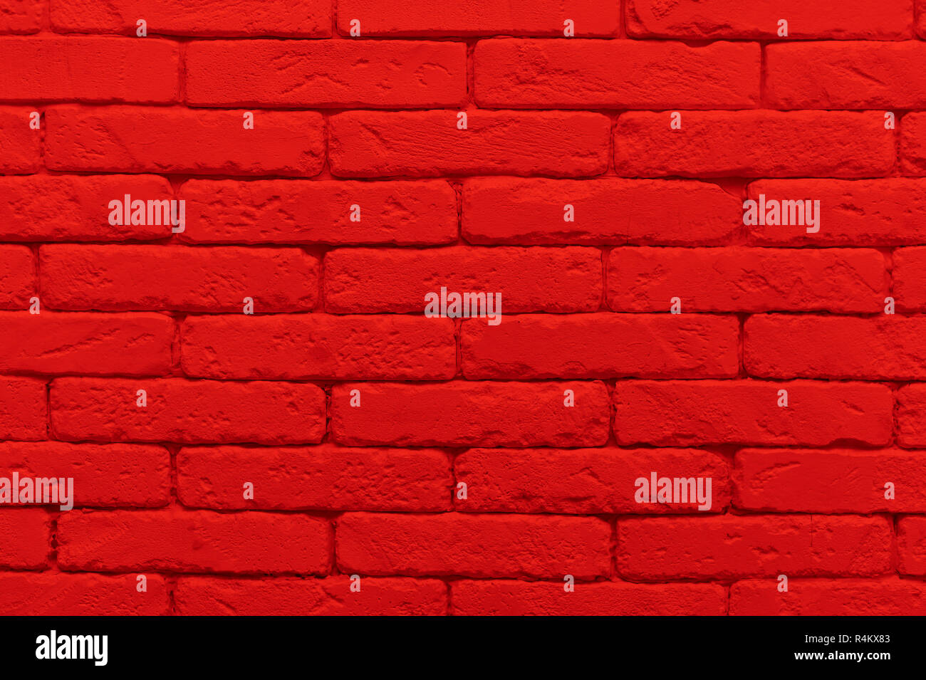 red brick wall painted at saturated scarlet colour  closeup