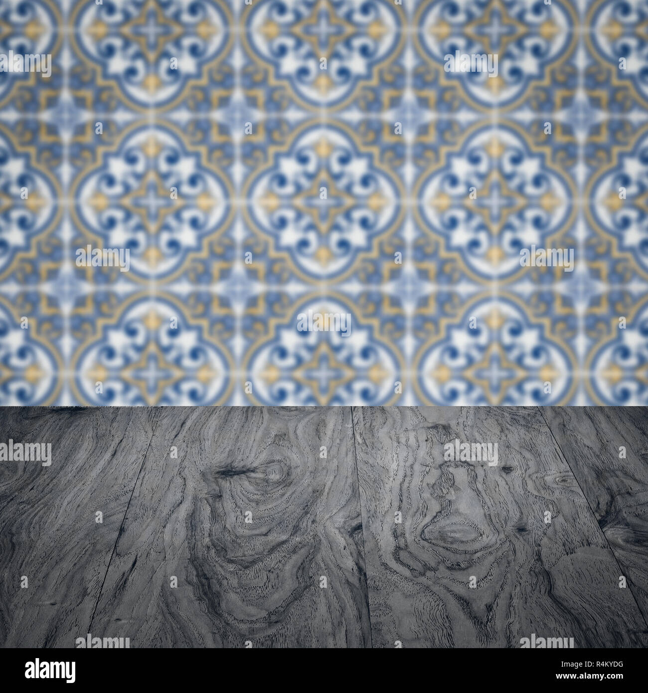 Empty Wood Table Top And Blur Vintage Ceramic Tile Pattern Wall In