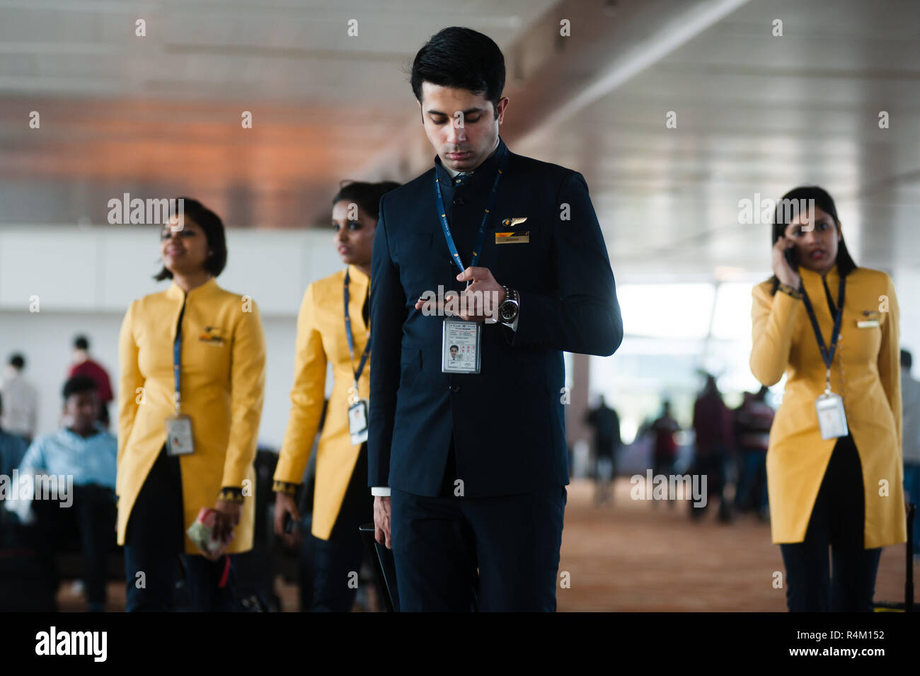 Photo of Jet Airways team of pilot and stewardesses going to flight. India, Indira Gandi Delhi Airport - 7 february 2018. - Stock Image