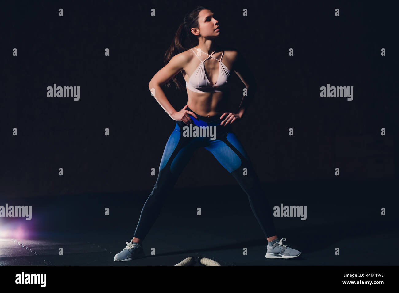 beautiful athletic woman working out with ropes box gym copyspace confidence motivation sports lifestyle activity hobby healthy powerful femininity training. - Stock Image