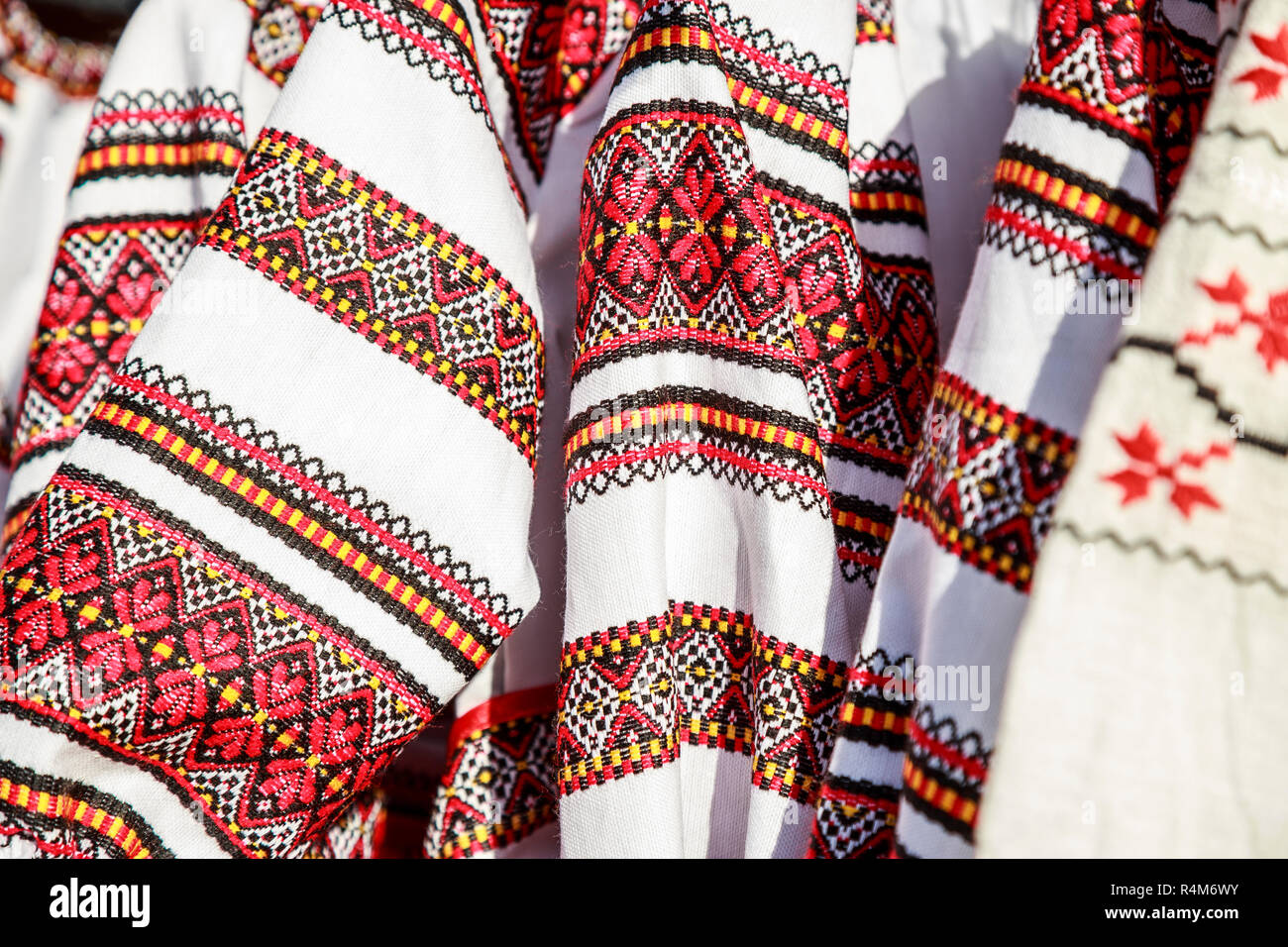 Close-up Romanian traditional costume, Ie. Ie Romanian traditional shirt. - Stock Image