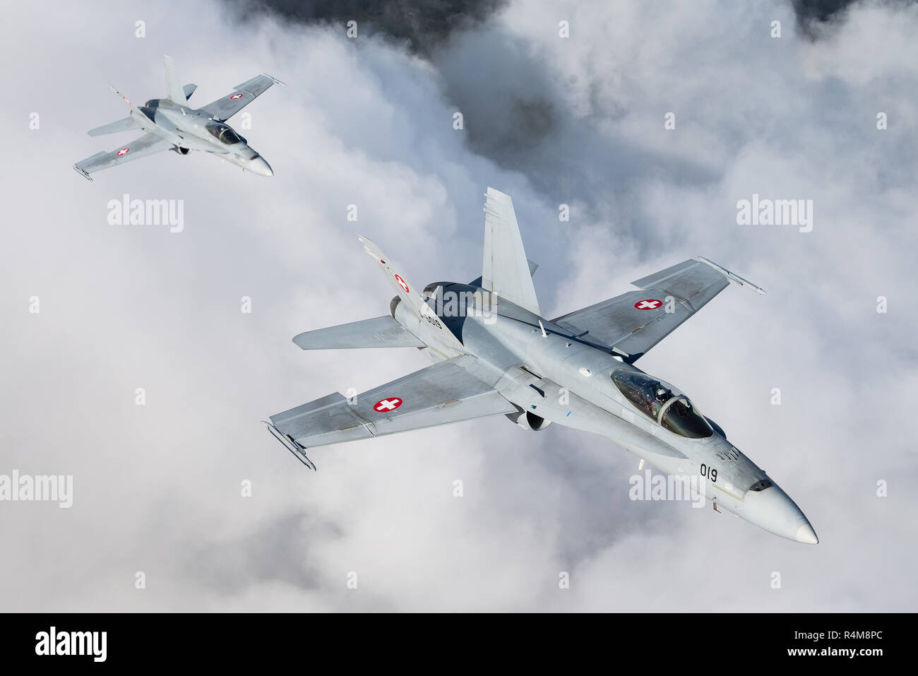 Flying with the McDonnell Douglas F/A-18C Hornet of the Swiss Air Force. - Stock Image