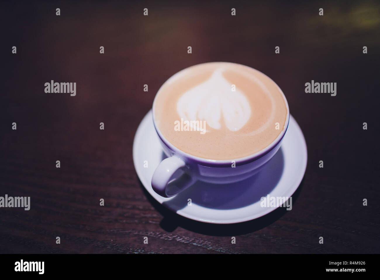 Coffee cup of Cafe' latte with heart latte art on top. Stock Photo