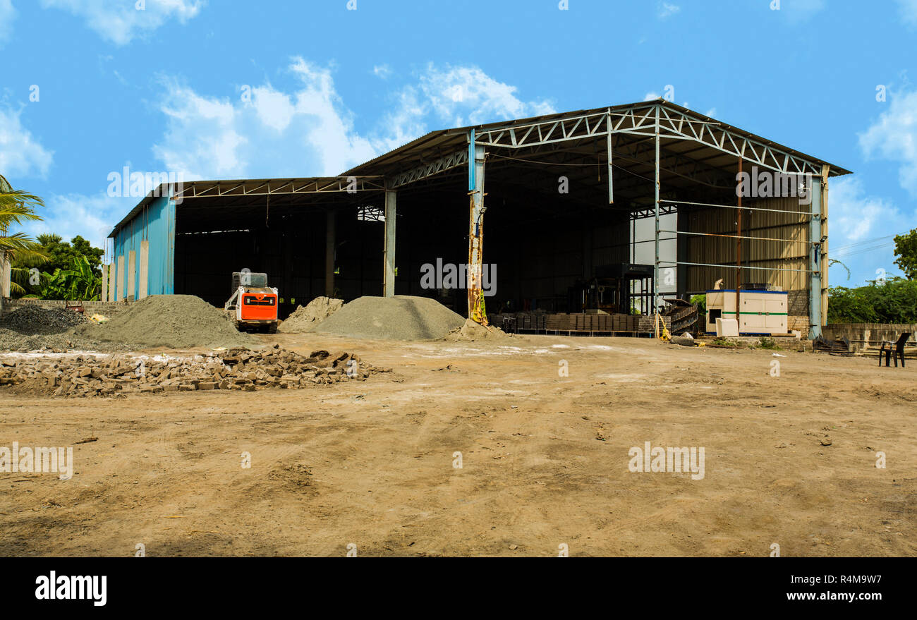 Factory building exterior with warehouse. Industrial production of cement products. Stock Photo