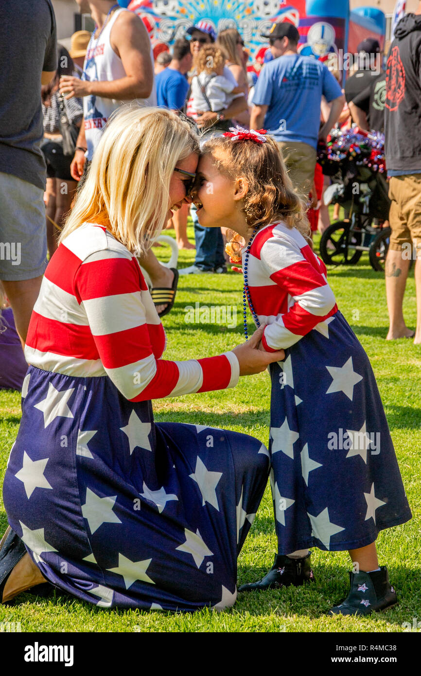 In matching stars and stripes, five-year-old Lauren Grant and mom Kasey only have eyes for each other.  (Photo by Spencer Grant) - Stock Image