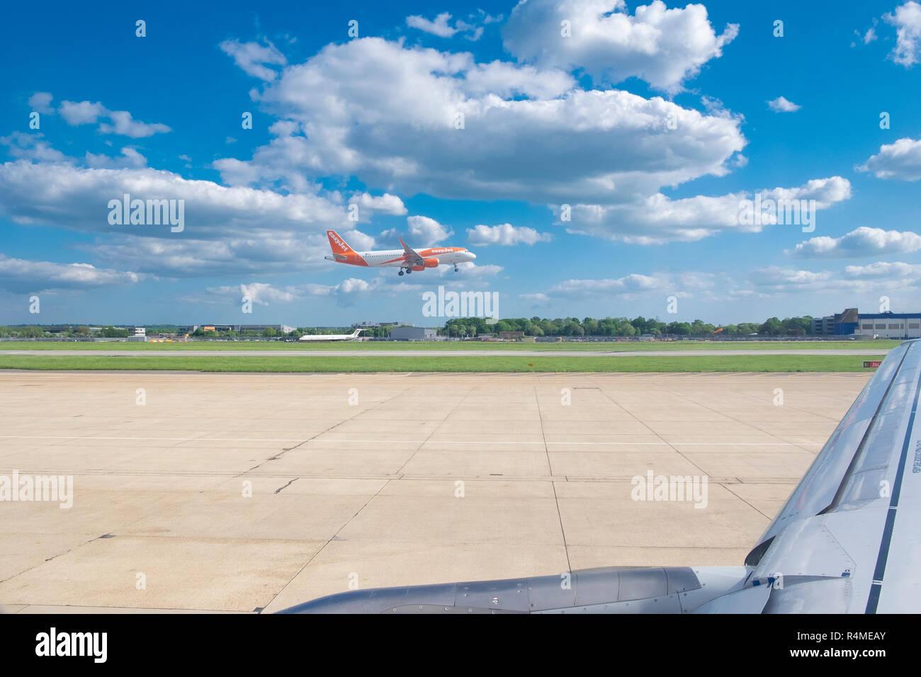 Easyjet plane landing at London Gatwick Airport, Sussex, UK - Stock Image