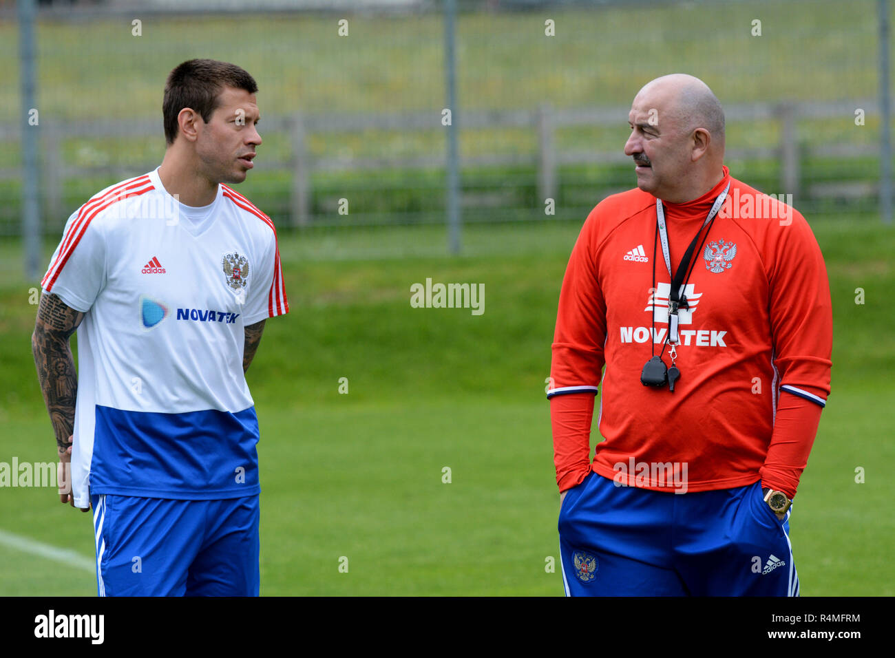 Russian national football team coach Stanislav Cherchesov with striker Fedor Smolov during training camp in Neustift, Austria. - Stock Image