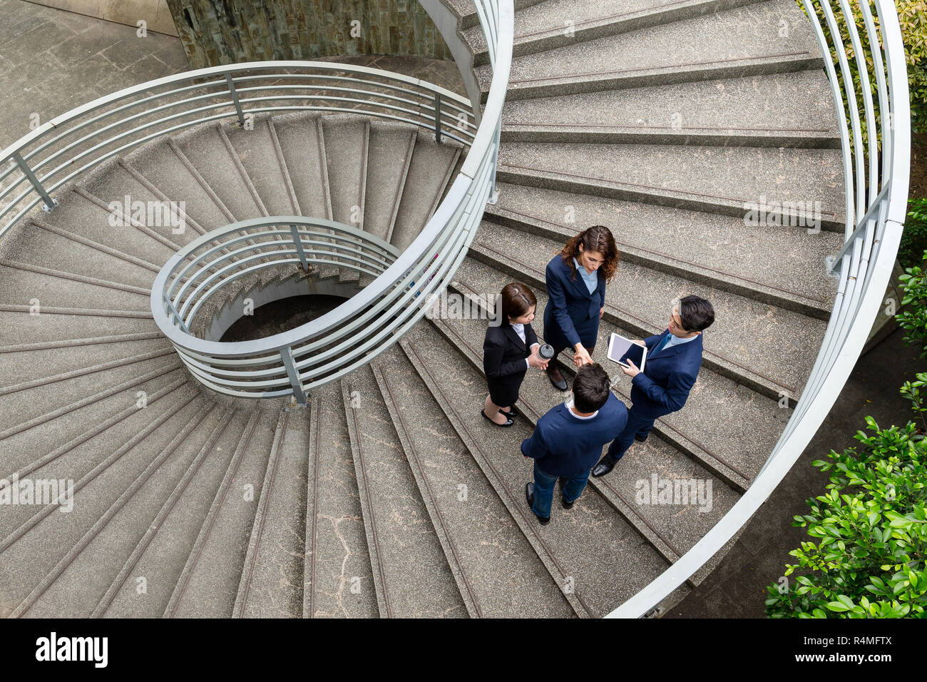 Top view of business people standing on step Stock Photo