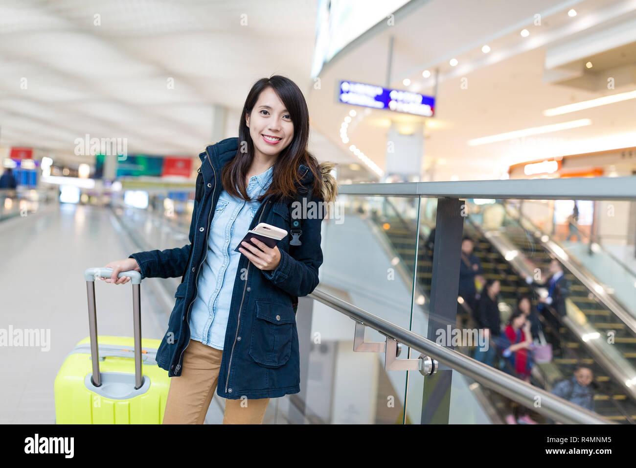 Woman go travel with her luggage at Hong Kong international airport - Stock Image