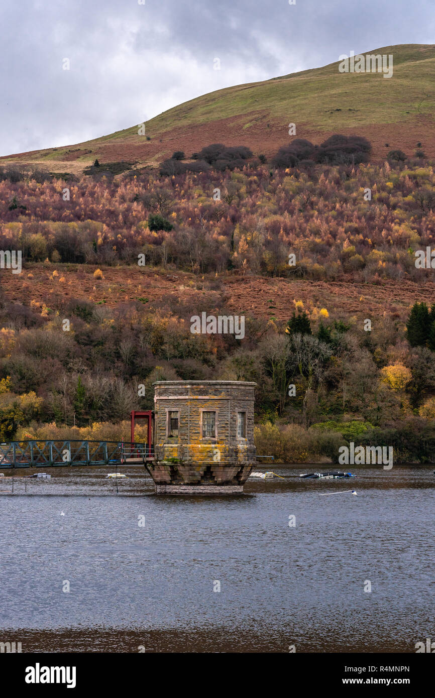 The reservoir valve tower at Talybont Reservoir in the Brecon Beacons National Park during autumn, Powys, Wales, UK - Stock Image