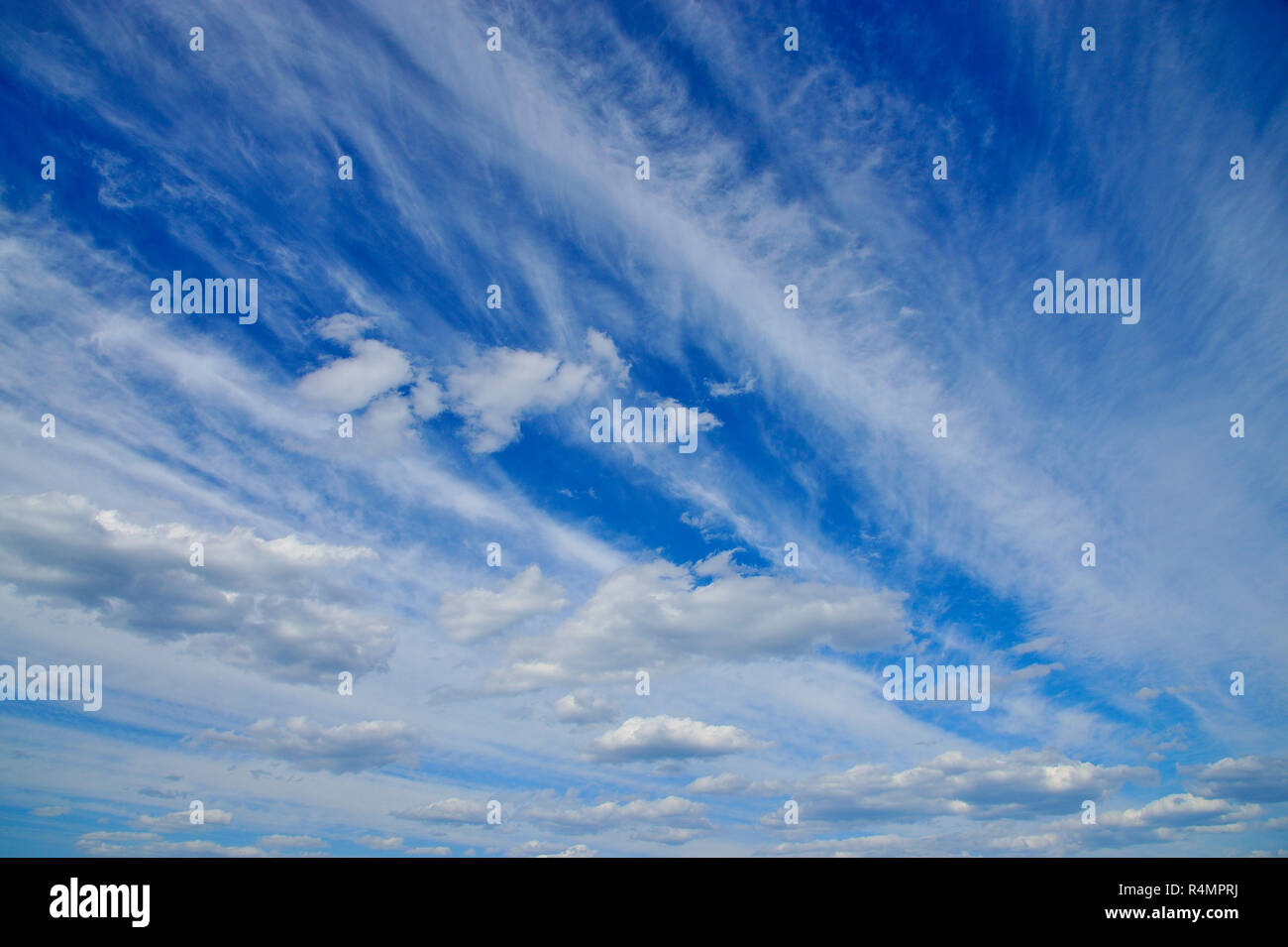 White cloud formations on a blue sky in rural Alberta Canada. - Stock Image