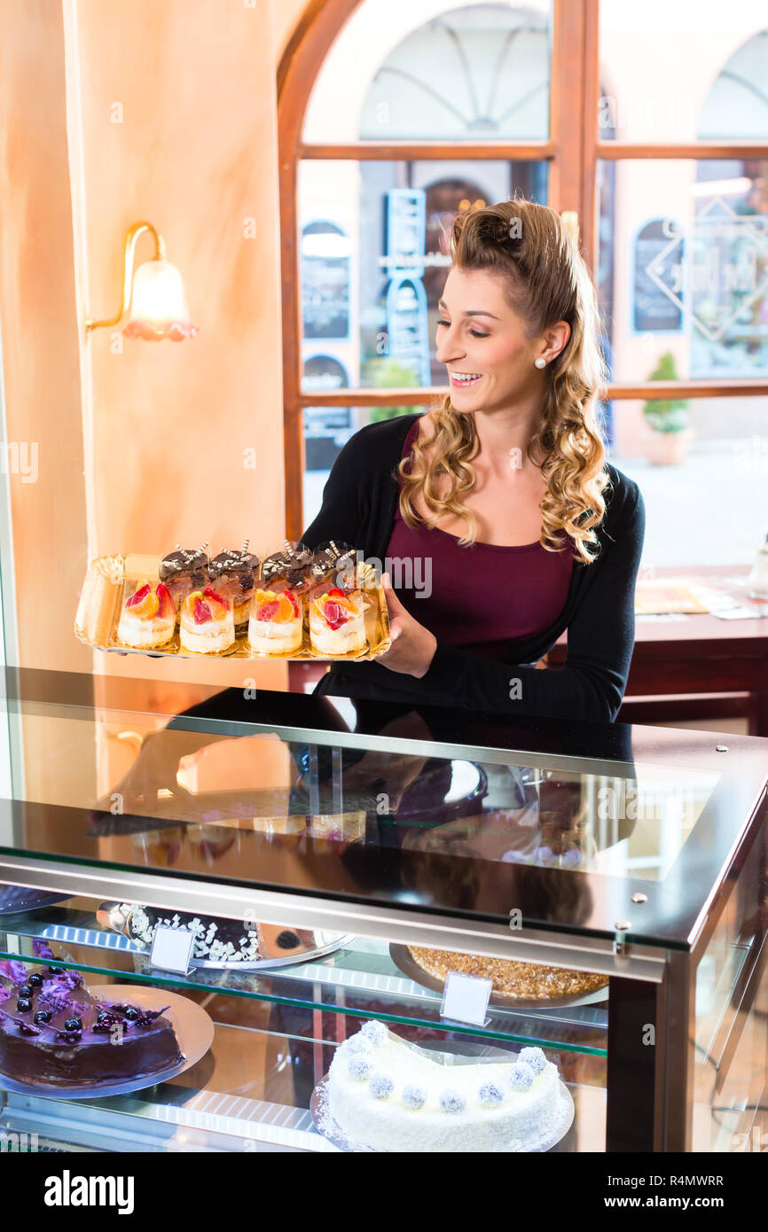 Female baker in confectionery Stock Photo