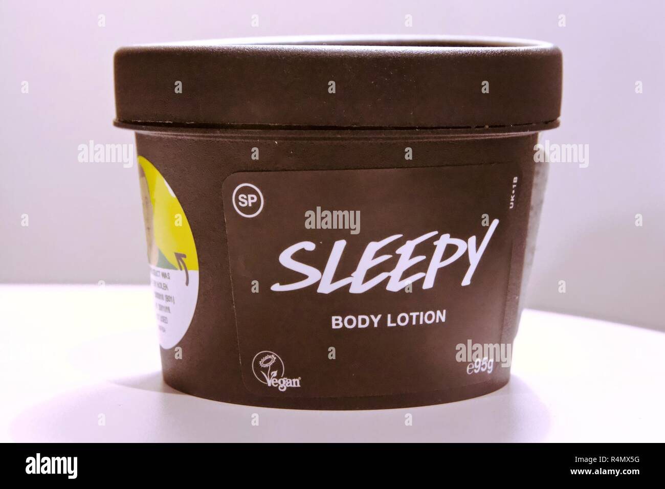 Lush Sleepy Body lotion is a vegan, cruelty free lotion made of lavender to help you fall asleep - Stock Image