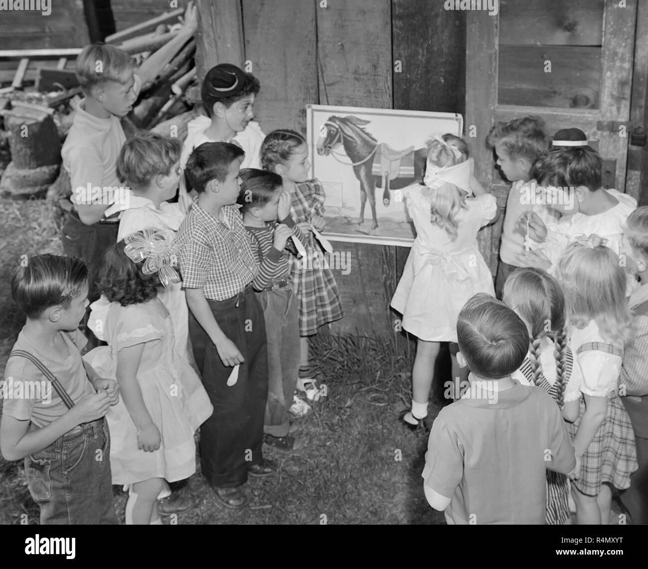Scene from a classic child's backyard birthday party in California, ca. 1949. Stock Photo